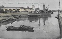 BELGIQUE -   1910 -  OSTENDE-   LA MINQUE AUX POISSONS ET BATEAU TIBURY -  CARTE COLORISEE  - VOIR VERSO - Oostende