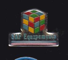 61961-Pin's.SKF France - Montigny-le-Bretonneux.Rubik's Cube.jeux.. - Jeux