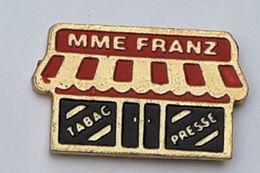 Z163 Pin's Tabac Presse Mme Franz Achat Immédiat - Marques