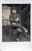 Carte Photo D'un Garde Champêtre Portant Des Sabot Posant Assis A La Campagne En 1916 - Identified Persons