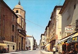 34 - Bédarieux - L'Eglise Et Rue Saint Alexandre - Bedarieux
