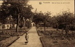 Cp Florenville Wallonien Luxemburg, Hotel De France, Un Coin Du Jardin, Mädchen Mit Schubkarre - Autres