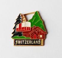 Pin's Switzerland Suisse Chalet Montagne Téléphérique -  RE/01 - Pins