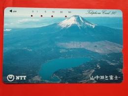 JAPAN - T-64,  PHONECARD MAGNETIC NTT - NATURE, LANDSCAPE, 250-445, VOLCANO - Japon