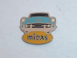 Pin's VOITURE MIDAS, Signe A.B. - Pins