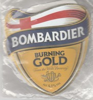 NEW SEALED - WELLS BREWERY (BEDFORD, ENGLAND) - BOMBARDIER BURNING GOLD - CURVED PUMP CLIP FRONT - Uithangborden