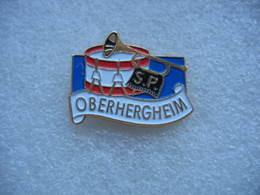 Pin's De La Fanfare Des Sapeurs Pompiers De La Ville De OBERHERGHEIM (Dépt 68) - Brandweerman