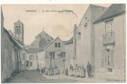 LOUVRES - La Rue Villeron Et L'Eglise - Louvres