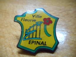 A050 -- Pin's Ville Fleurie Epinal - Ciudades