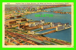 DULUTH, MN - AIRPLANE VIEW OF GRAIN ELEVATORS, LIFT BRIDGE AND ENTRANCE TO DULUTH-SUPERIOR HARBOR - TRAVEL IN 1958 - - Duluth