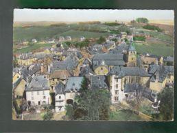 CP (15) En Avion Au Dessus De ... Montsalvy - Château, église Et Vue Générale - France