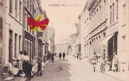 FLEURUS - Rue De La Station - Carte Très Animée Avec Imprimerie Sur La Droite De La Carte Et Circulé En 1922 - Fleurus