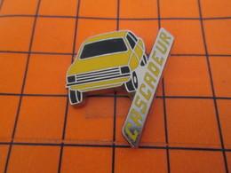 912A Pin's Pins / Beau Et Rare / THEME : AUTOMOBILES / VOITURE JAUNE CASCADEUR - Pins