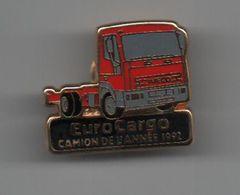Pin's Camion IVECO Eurocargo, Camion De L'année 1992, Dos Doré Par PRAXIS ..................BT19 - Pins