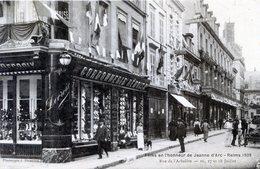 51  REIMS  FETES JEANNE D'ARC EN 1909  RUE DE L'ARBALETE  MAGASIN LA CORDONNERIE REMOISE - Reims