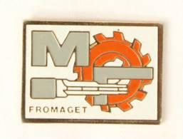Pin's FROMAGET - Roue Dentelée Et Clé - J308 - Merken