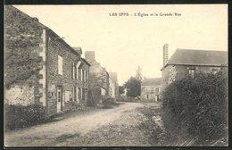 CPA Les Iffs, L`Eglise Et La Grande Rue - France