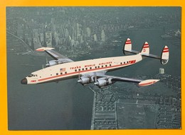 12082 -  Lockheed L-1049G Super  G Constellation TWA Near Lower Manhattan Island - 1946-....: Ere Moderne