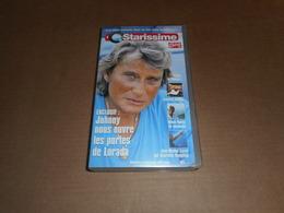 Cassette VHS - Johnny Hallyday -  Starissime - Avec Coluche, Mimie Mathy, Jean Michel Jarre ... - Conciertos Y Música
