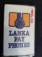 SRI LANKA RS 100 LANKA PAY PHONES MINT IN BLISTER SERIE NO 16SRLA  (EARLY CARD)    **909 ** - Sri Lanka (Ceilán)