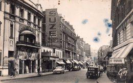 CPSM Dentelée, Asnières, La Rue De La Station Animée, Commerces, Pub Suze - Asnieres Sur Seine