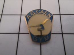 816c Pin's Pins / Beau Et Rare / THEME : SPORTS / GYMNASTIQUE CLUB AG CAEN AVANT GARDE CAENNAISE - Gymnastique