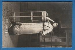 CARTE PHOTO FEMME ACCOUDE SUR UNE SELETTE PHOTOGRAPHIE LOUIS - Photographs
