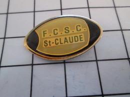 916a Pin's Pins / Beau Et Rare / THEME : SPORTS / RUGBY BALLON OVALE CLUB FCSC ST CLAUDE - Rugby