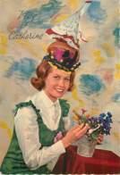SAINTE CATHERINE - Femme Avec Robe Verte Et Chapeau Multicolore Avec Petit Chien En Peluche - Sainte-Catherine