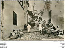 Photo Cpsm Cpm Maroc. OUEZZANE. Rue Du Mellah. Pour Neuilly Sur Seine. Timbre Manquant - Non Classés