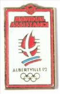 Pin's Officiel JO ALBERTVILLE 92 - Sponsor MONDIAL ASSISTANCE - Logo Des JO - Cojo - J390 - Giochi Olimpici