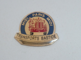 Pin's TRANSPORTS BASTIDE, MIDI-PARIS-MIDI - Trasporti