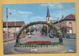 C.P.M. Moyeuvre-Grande - Rond-Point De La Gare Et Le Temple - Autres Communes