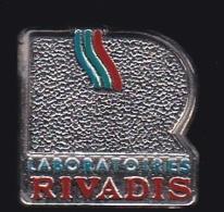 64476-Pin's.Laboratoire Rivadis à Louzy Fabricants, Grossistes En Parfumerie, Cosmétiques - Parfums