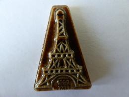 FEVE - FEVES - ANCIENNE - PORCELAINE EMAILLÉE BRUN FONCÉ  - LA TOUR EIFFEL - CENTENAIRE 1889 -1989 - Antiguos