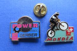 2 Pin's,CYCLISME,POWER BIKE,MONDIA,VELO-SPORT,SUISSE - Cyclisme