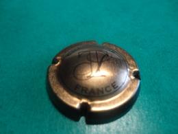 CAPSULE DE CHAMPAGNE  - TRIBAUT Schloesser -  N°  26  Fond Cuivre-rosé - Champagne