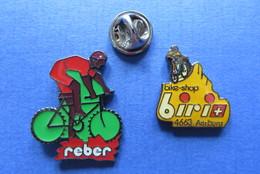 2 Pin's,CYCLISME,REBER,BIRI BIKE-SHOP,VELO,RADSPORT,SUISSE - Cyclisme