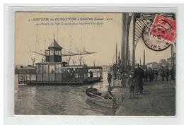 44 NANTES SOUVENIR DES INONDATIONS JANVIER 1910 LA NACELLE DU PONT TRANSBORDEUR TOUCHANT LA LOIRE N° 9 - Nantes