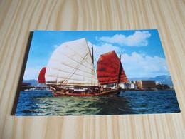 A Junk Sails Across Scenic Hong Kong Harbour... - China (Hongkong)