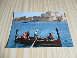 Malta - The Dghajsa' (Malta's Water Taxi) And The Historic Fort St. Angelo. - Malta