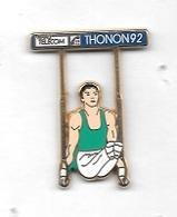 Pin's  Ville, ARTHUS  BERTRAND, FRANCE  TELECOM, Sport  Gymnastique THONON  92  Homme  Maillot Vert  Aux  Anneaux ( 74 ) - Ginnastica
