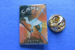 Pin's,CAMEL ART 12,CIGARETTES,TABAC,PAQUET,SUISSE - Trademarks