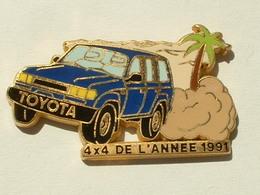 PIN'S TOYOTA STATION WAGON BLEU - 4 X 4 DE L'ANNEE 1991 - ARTHUS BERTRAND - Toyota