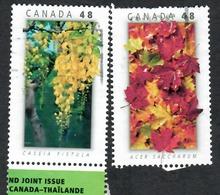 Sc. # Sc # 2301 & 02 National Emblems Thailand/Canada Joint Issue Pair 2003 Used K621 - 1952-.... Règne D'Elizabeth II