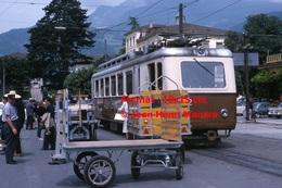 Reproduction D'une Photographie Du Chargement De Colis De La Poste Dans Un Train Aigle-Leysin A.L à Aigle En Suisse 1965 - Reproductions
