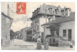 Cpa...Divonne-les-Bains...grande Rue..animée...commerces...coiffeur,café.... - Divonne Les Bains