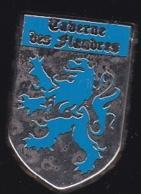65387-Pin's-Brasserie Taverne Des Flandres Paris.signé Them Sigle 24. - Villes