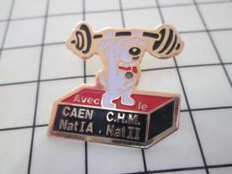 217 Pin's Pins / Beau Et Rare / THEME : SPORTS / HALTEROPHILIE CHIEN HALTERES CLUB CAEN CHM - Gewichtheben