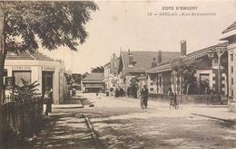 CPA 33 Gironde Cote D'Argent Soulac Rue Brémontier - Vitrerie P. Lavaud - A La Ménagère - Cyclistes - Soulac-sur-Mer